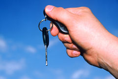 Car Keys. Hand holding car key against a blue sky Royalty Free Stock Photo