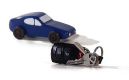 Car Keys. Remote openner with keys in front of a toy car Royalty Free Stock Photography
