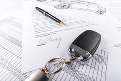 Car keys on agreement document Stock Image