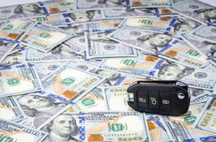 Car keys on american dollars money background Royalty Free Stock Images