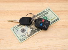 Car keys atop money Stock Photos