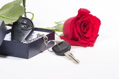 Car keys and beautiful rose. Single beautiful scarlet rose and car keys in box as a Valentine day gift stock photos