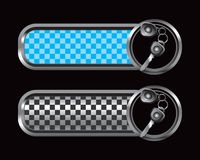 Car keys on blue and black checkered tabs Royalty Free Stock Photo