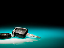 Car keys on blue, reflective table Royalty Free Stock Photos