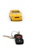 Car keys and car at background Stock Photos
