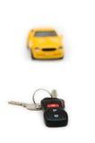 Car keys and car at background Stock Photos