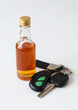 Car keys and alcohol bottle Royalty Free Stock Photography
