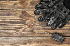 Car keys and driving gloves. Car keys and a pair of leather driving gloves royalty free stock images