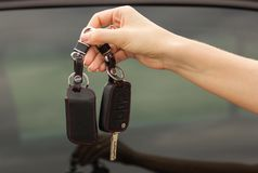 Car keys in a female hand, close-up stock photos