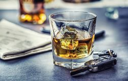 Car keys and glass of alcohol on table in pub or restaurant stock photography