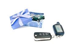Car keys, green car and blue gift box Stock Photography
