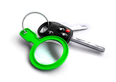 Car keys with a green magnifying glass as a keyring Royalty Free Stock Photo