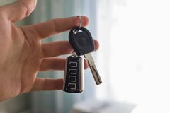 Car keys in hand, on the street automobile stock photos