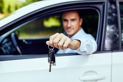 Car keys in the hand of a young driver royalty free stock photography