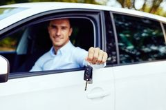 Car keys in the hand of a young man stock images