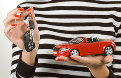 Car and keys in hands Royalty Free Stock Photography