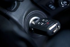 Car Keys in Ignition Keyhole. Modern Car Keys with Remote in Ignition Keyhole Royalty Free Stock Photos