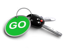 Car Keys with keyring: GO!. Set of car keys with a keyring. The keyring has a GO traffic sign, road sign on it stock illustration