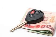 Car keys lay on the greenback isolated on white background with Royalty Free Stock Photography
