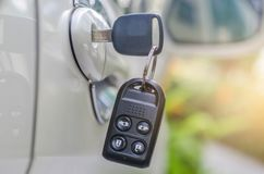 Car keys left in a lock. In park Stock Photo