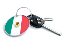 Car keys with Mexico flag as keyring. Car keys with Mexican flag as keyring. Concept for cars manufactured and sold in Mexico. Mexican car brands and makes of stock photo