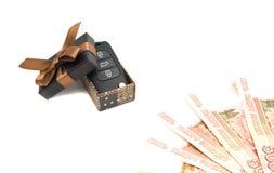 Car keys, money and brown gift box Stock Photo
