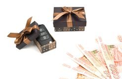 Car keys, money and brown gift boxes Royalty Free Stock Photography