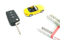 Car with keys and money on white Royalty Free Stock Images
