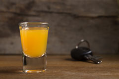 Car keys with one shot glasses. Over wood background - drink drive concept Stock Photos