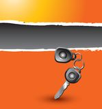 Car keys on orange ripped banner Royalty Free Stock Image