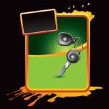 Car keys on orange splattered advertisement Royalty Free Stock Photos
