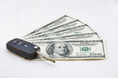 Car keys over dollar banknotes Stock Photography
