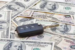 Car keys over dollar banknotes Royalty Free Stock Image