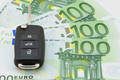 Car keys over euro banknotes Royalty Free Stock Photo