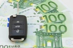 Car keys over euro banknotes Royalty Free Stock Photo