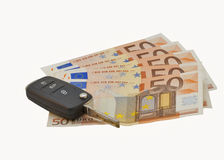 Car keys over euro banknotes Stock Photo