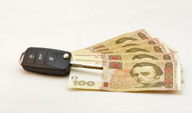 Car keys over Ukrainian banknotes Stock Photos