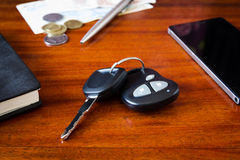 Car keys, phone and money Royalty Free Stock Photography