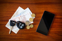 Car keys, phone and money Royalty Free Stock Photo