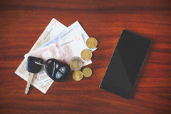 Car keys, phone and money Royalty Free Stock Photos