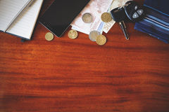 Car keys, phone and money Royalty Free Stock Images