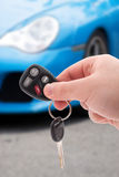 Car Keys and Remote. A hand holding car keys and a remote control for keyless entry Royalty Free Stock Photography