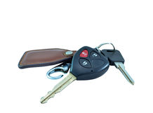 Car keys and remote alarm controller. On a white background Stock Photos