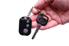 Car keys and remote control alarm system. Automobile keys and remote control panel from the car alarm system in a hand Royalty Free Stock Photos