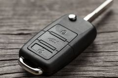 Car keys with remote control alarms on wooden background. Car keys with remote control alarms on wooden background royalty free stock photography