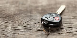 Car keys with remote control alarms on wooden background. Copy space for text. Car keys with remote control alarms on wooden background. Copy space for text stock photography