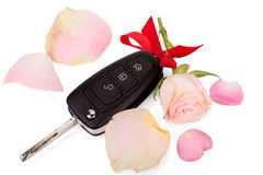 Car keys with ribbon and flowers as a gift isolated Royalty Free Stock Photos
