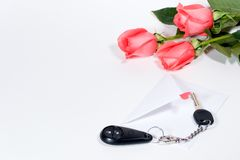 Car keys and roses bouquet present. Car keys as a Valentine day gift Royalty Free Stock Photos