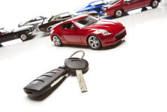 Car Keys and Several Sports Cars on White Stock Image