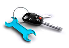 Car keys with spanner icon keyring. Concept for vehicle maintenance and servicing plan. Royalty Free Stock Photo